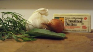 ingredients for a garlic, shallot, sage, and tarragon compound butter