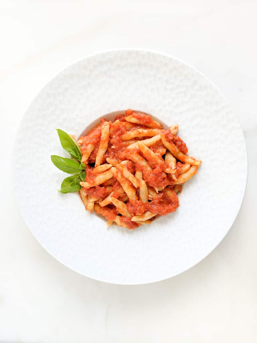 homemade fusilli in red sauce