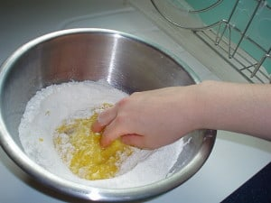 stirring the eggs into the flour