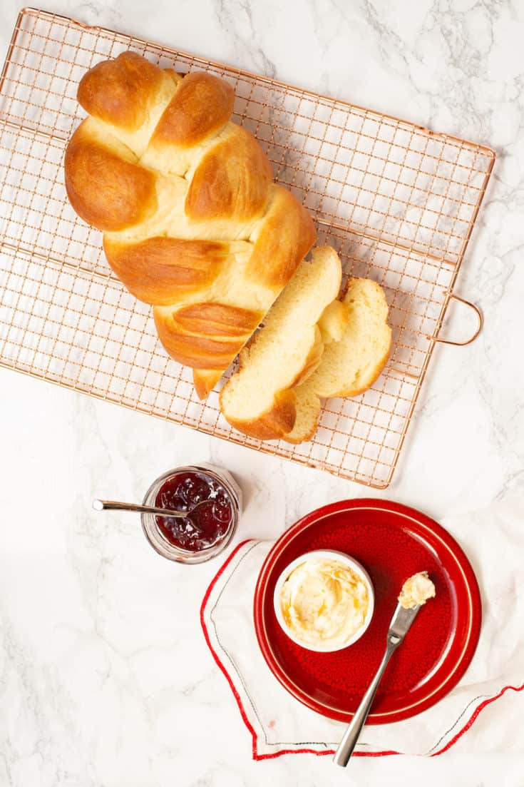 Braided Swiss bread is similar to challah and has the same eggy, sweet texture and flavor. Serve with honey butter, fig jam, charcuterie, or cheese. #swissbread #braidedbread #eggbread