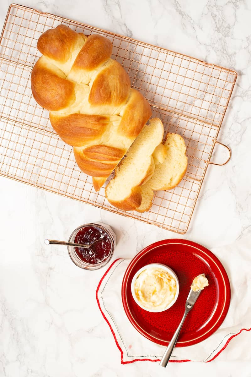 Braided Swiss bread is similar to challah and has the same eggy, sweet texture and flavor. Serve with honey butter, fig jam, charcuterie, or cheese. #eggbread #braidedbread #swissbread