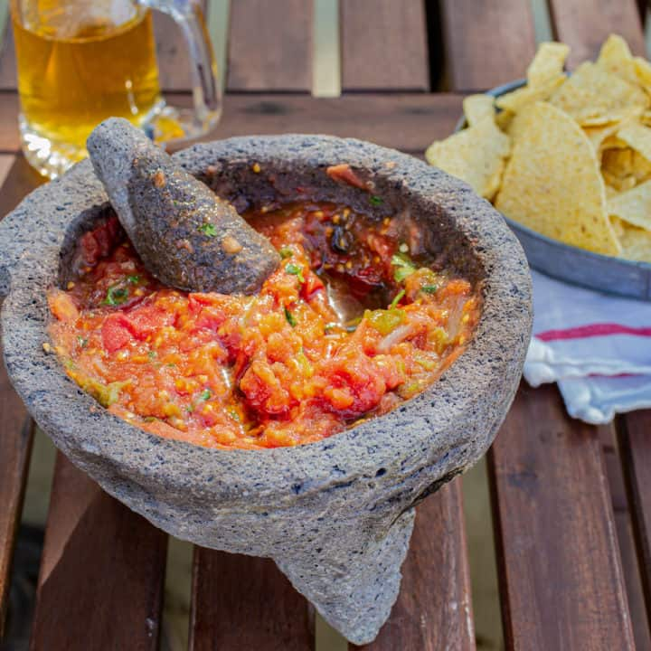 salsa in a molcajete with chips