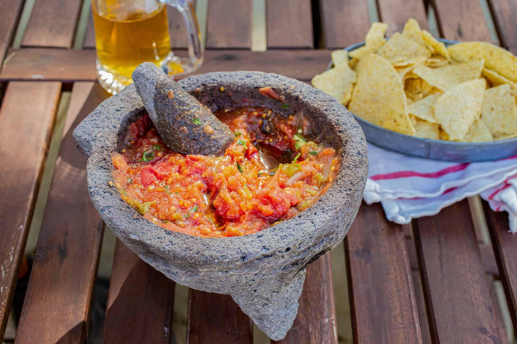 How to Season a Molcajete and Make Tomato Salsa
