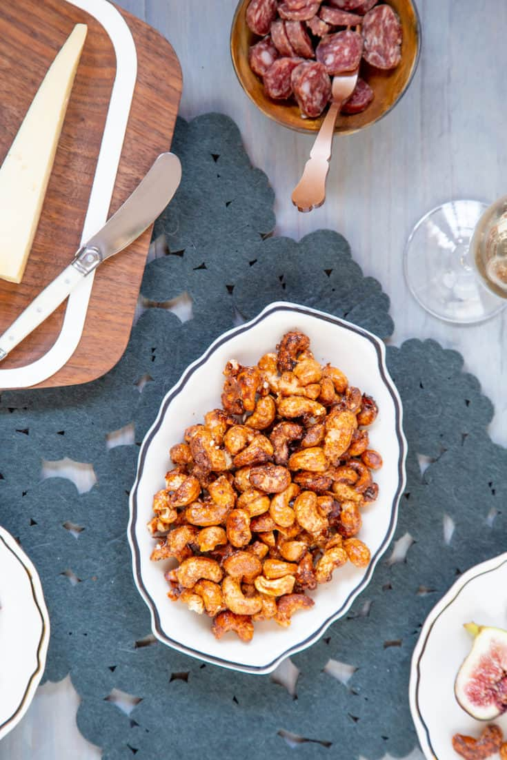 Spiced nuts are a saving grace for the overbooked party host. Mix up a quick batch of Thai spiced cashews for your next shindig. #spicednuts #thaispicedcashews #partysnacks