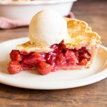 cherry pie slice with vanilla ice cream