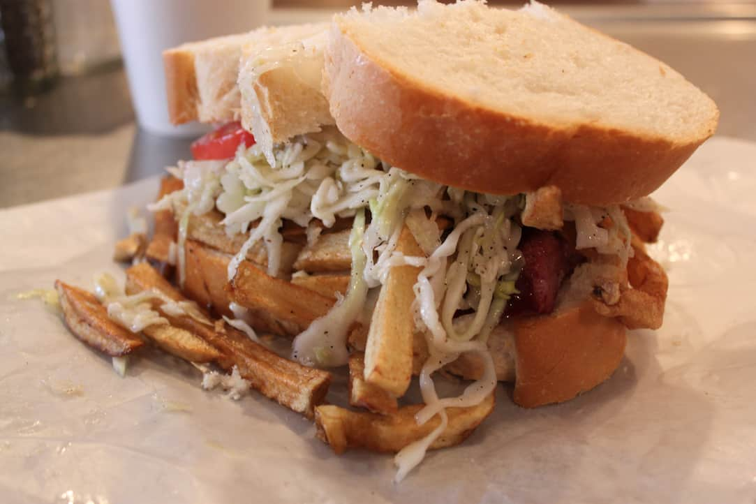Primanti's sandwich in Pittsburgh with fries and coleslaw, via www.goodfoodstories.com