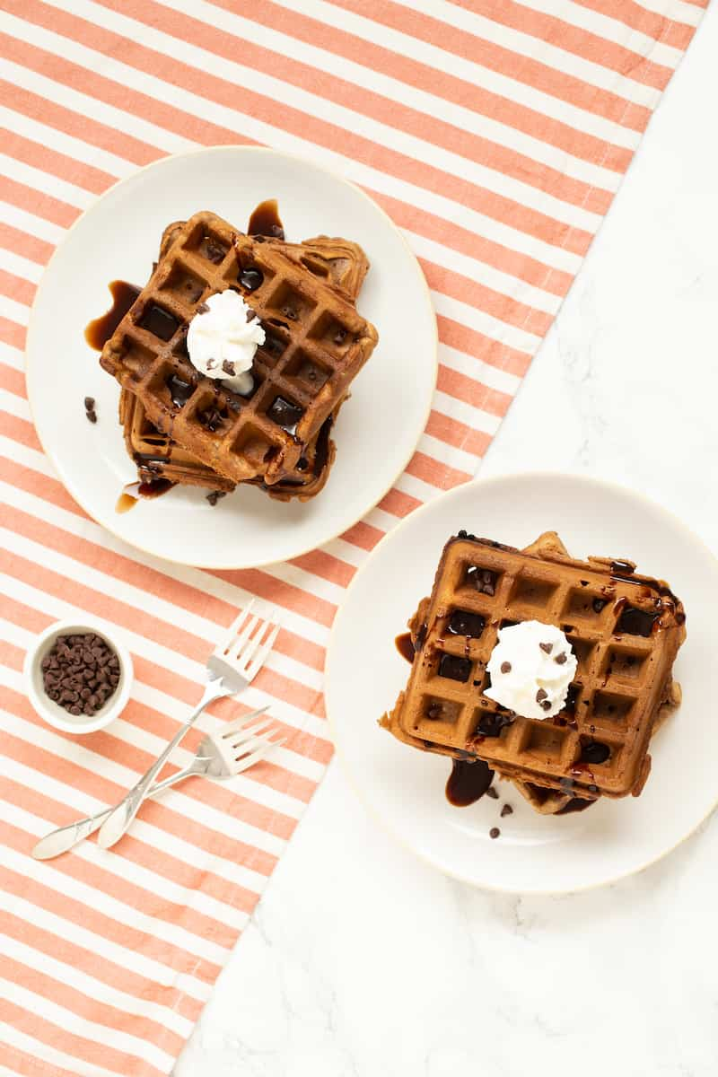 Cocoa waffles are light and crispy with just a hint of sweetness from mini chocolate chips. And they're very fluffy, thanks to folded egg whites in the batter. #brunch #weekendbreakfast #waffles