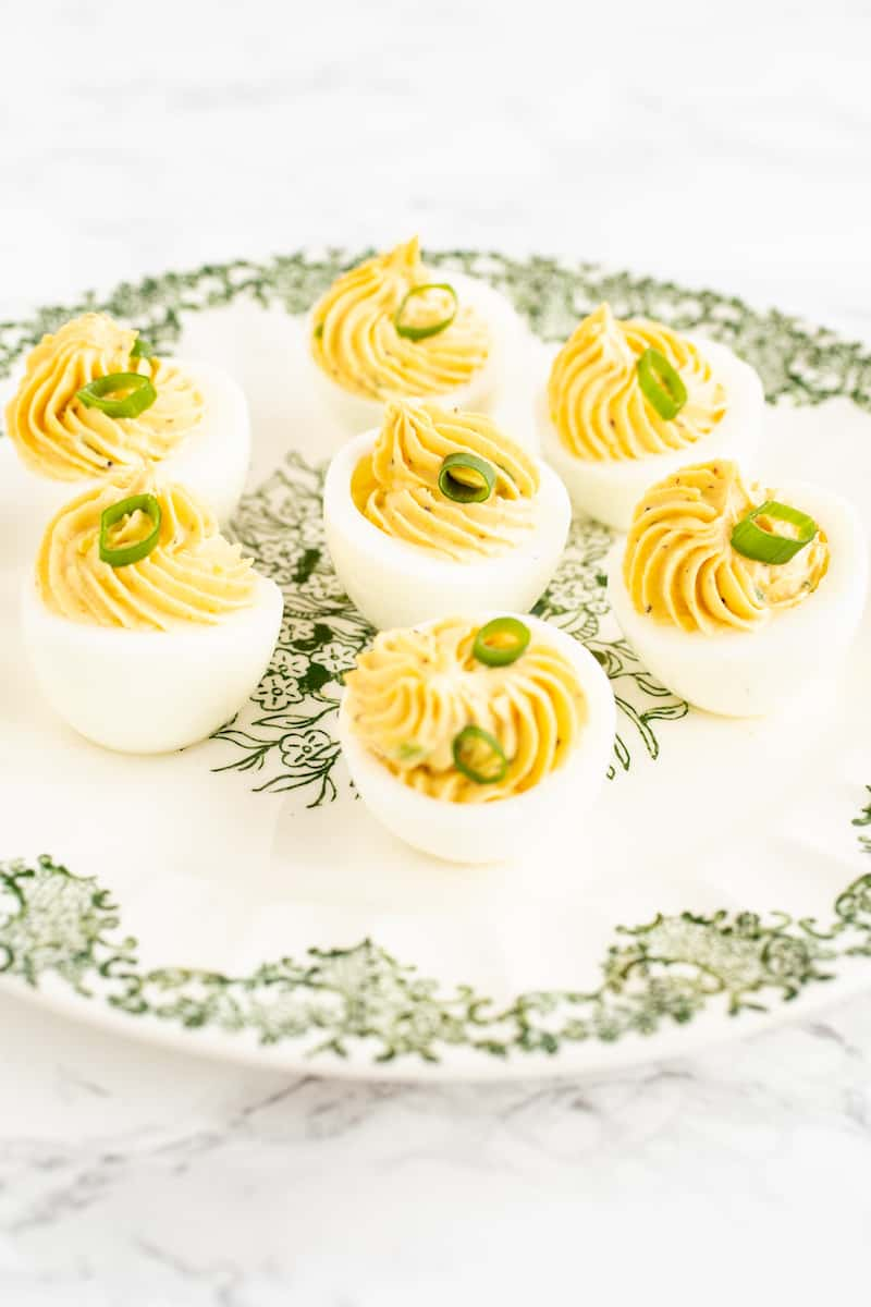 Deviled eggs, the classic party snack, have infinite variations. Here's a simple recipe with many options for garnishes and add-ins to make them your own. #deviledeggs