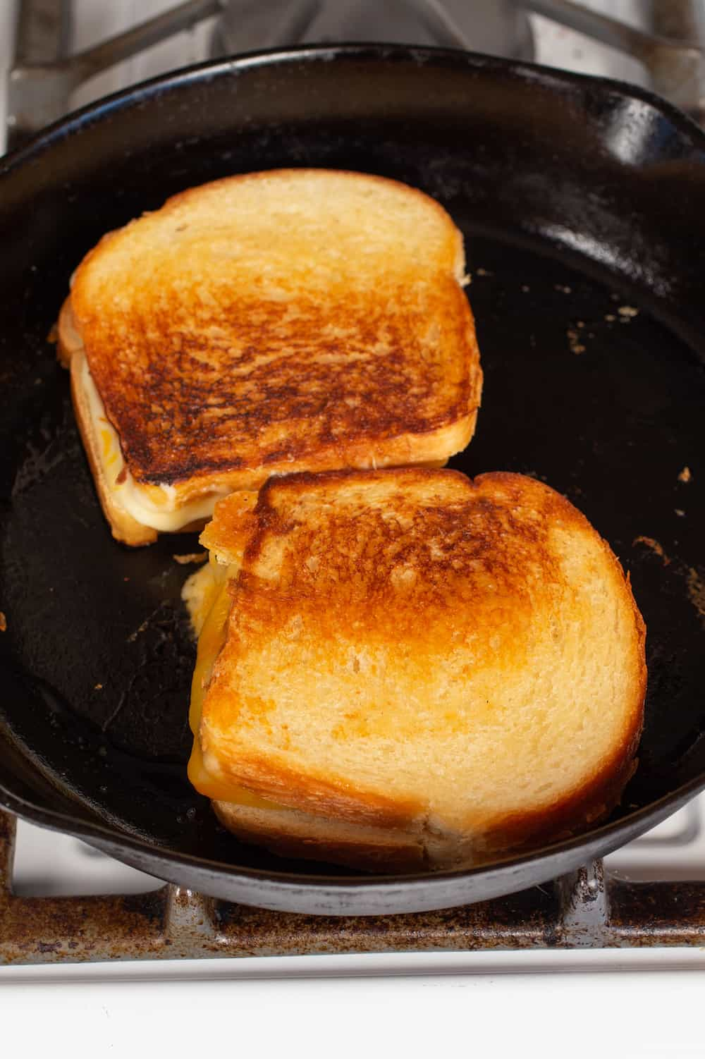 grilled cheese sandwiches in cast iron pan