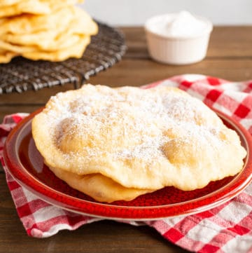 fried dough with powdered sugar