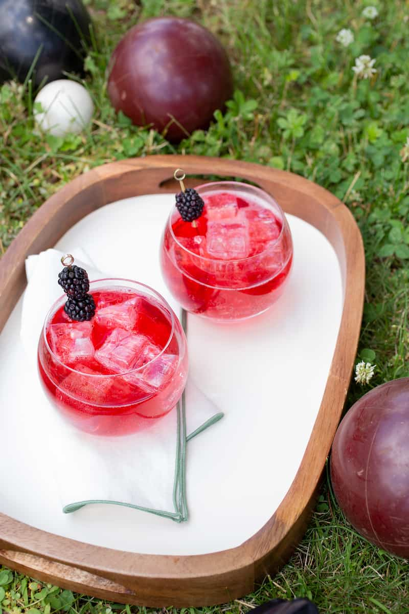 blackberry campari cocktail inspired by the game of bocce