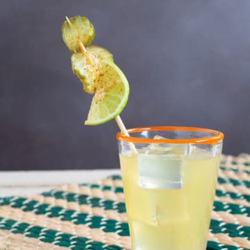 The Pickled Surfer is a mellow cocktail based on a pickleback - a surprising combination of whiskey, pickle juice and lime that goes down easy.
