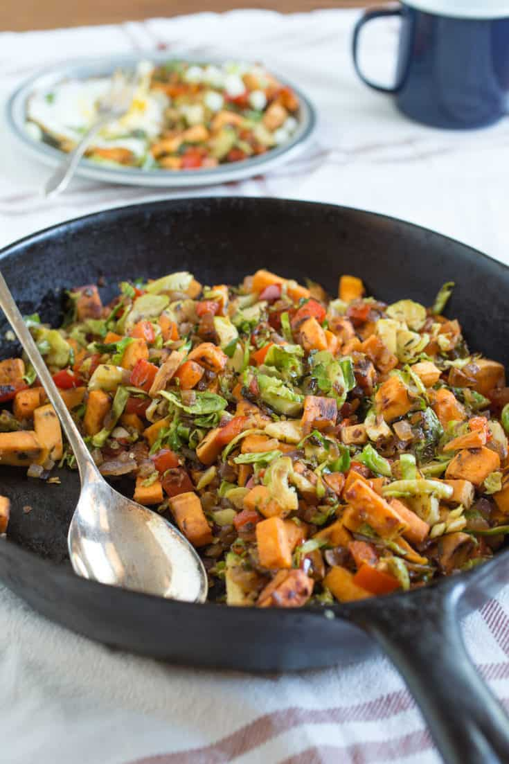 This sweet potato hash with Brussels sprouts is a complete meal for breakfast, lunch, or dinner—you can't go wrong any way you assemble it! #sweetpotatohash #breakfasthash #makeaheadbreakfast