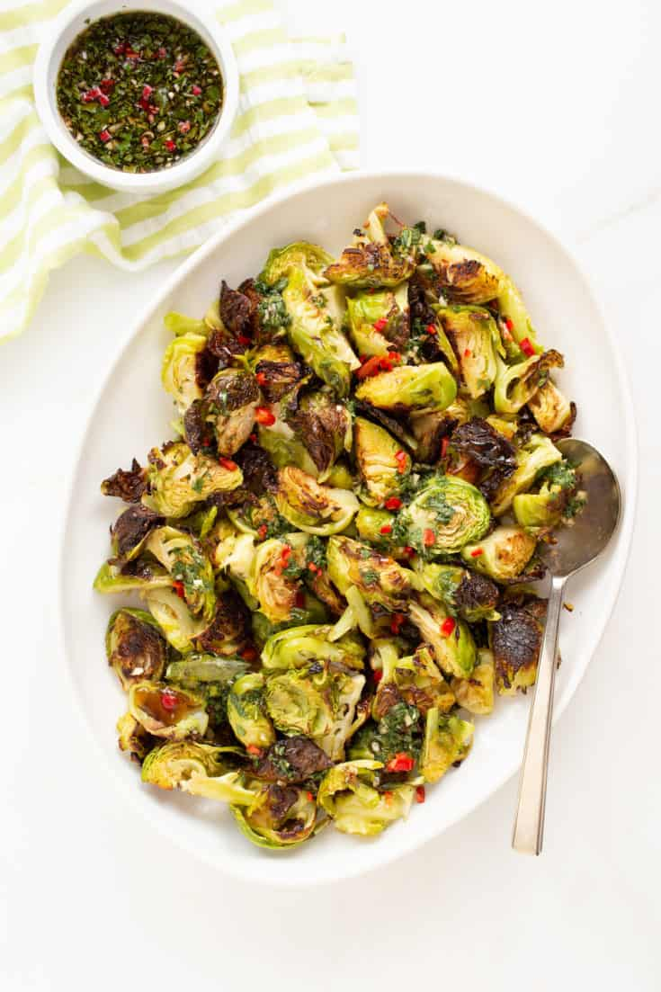 Roasted Brussels sprouts with a sweet and salty Asian dressing brings out the natural sweetness in the vegetable. Even haters will think differently. #roastedbrusselssprouts #thanksgiving #sidedish #asian