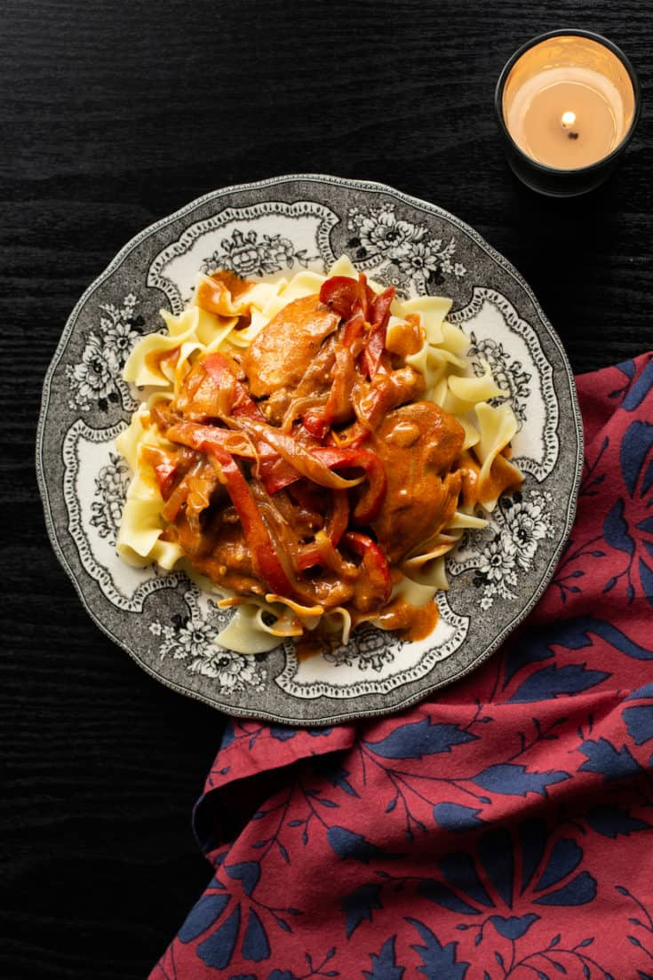 Chicken paprikash, the traditional Hungarian stew, is thick and velvety with the subtle flavors of paprika and sour cream. It's perfect over noodles or rice. #paprikash #stew