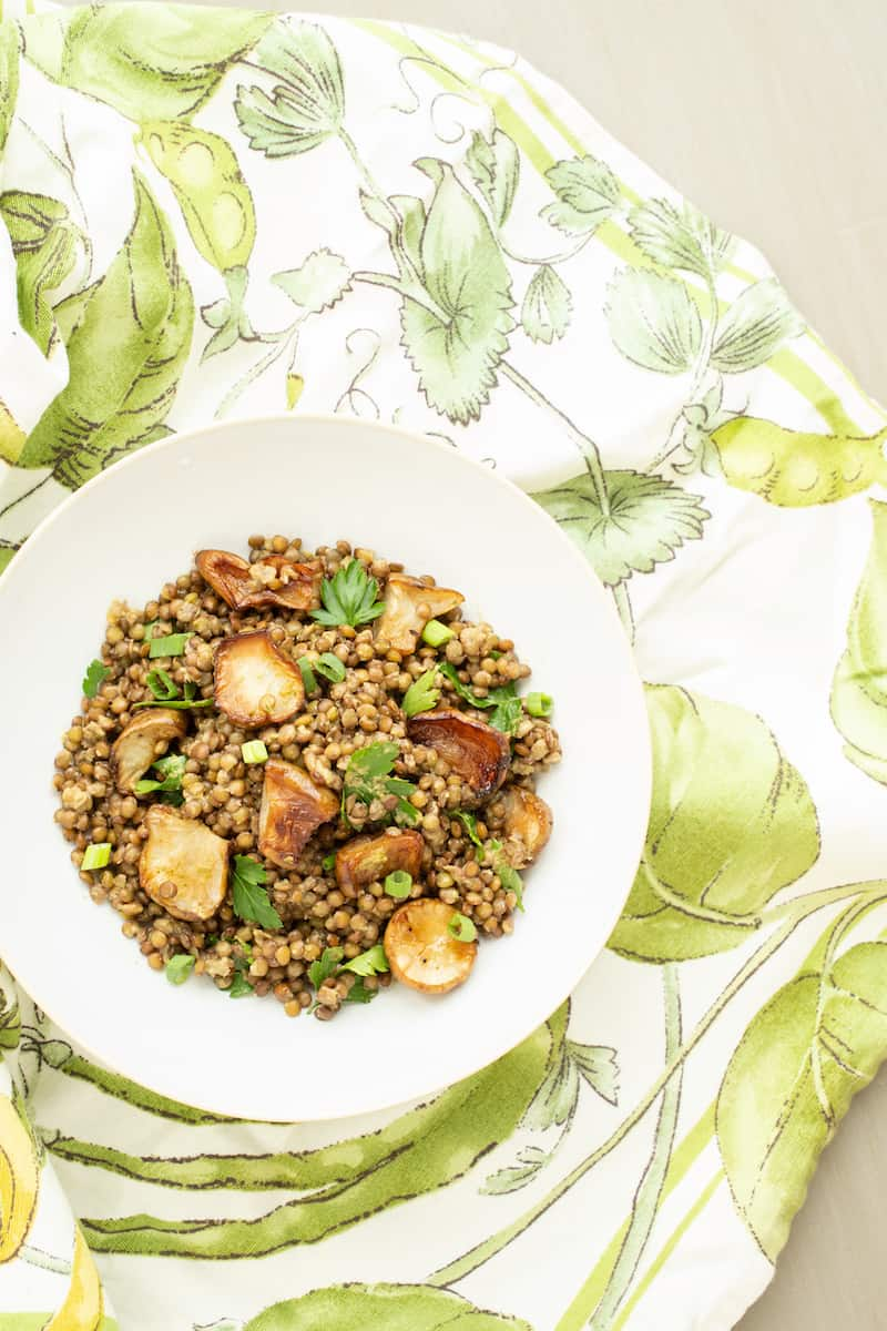 A warm lentil salad mixes French lentils with roasted Jerusalem artichokes, or sunchokes, in a cozy and comforting vegetarian winter dish.