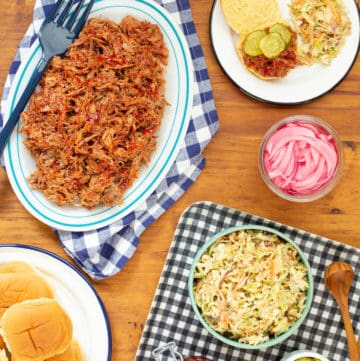 This slow cooker pulled pork lets you feed a crowd without mess or difficulty—or monitoring the meat! #slowcooker #pulledpork