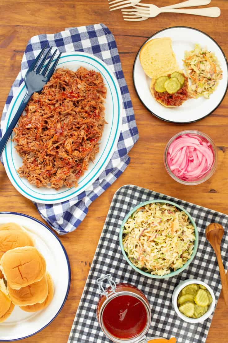 This slow cooker pulled pork lets you feed a crowd without mess or difficulty—or monitoring the meat! Toss it with homemade honey barbecue sauce. #slowcooker #pulledpork #honeybarbecue