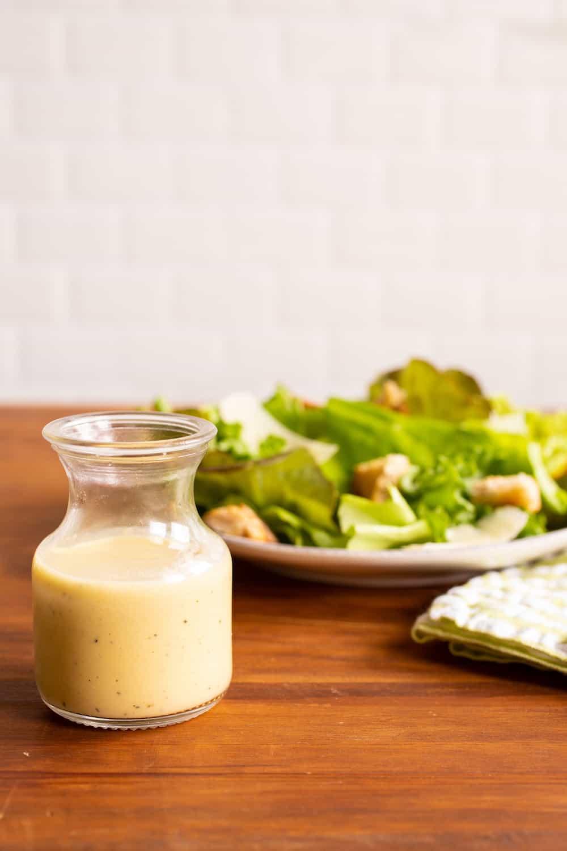 caesar dressing carafe and salad