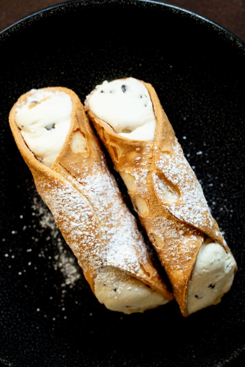 The many kinds of Italian pastry, like cannoli, struffoli, sfogliatelle, and minni di virgini, are sinfully delicious. But they have a religious history. #italianpastry