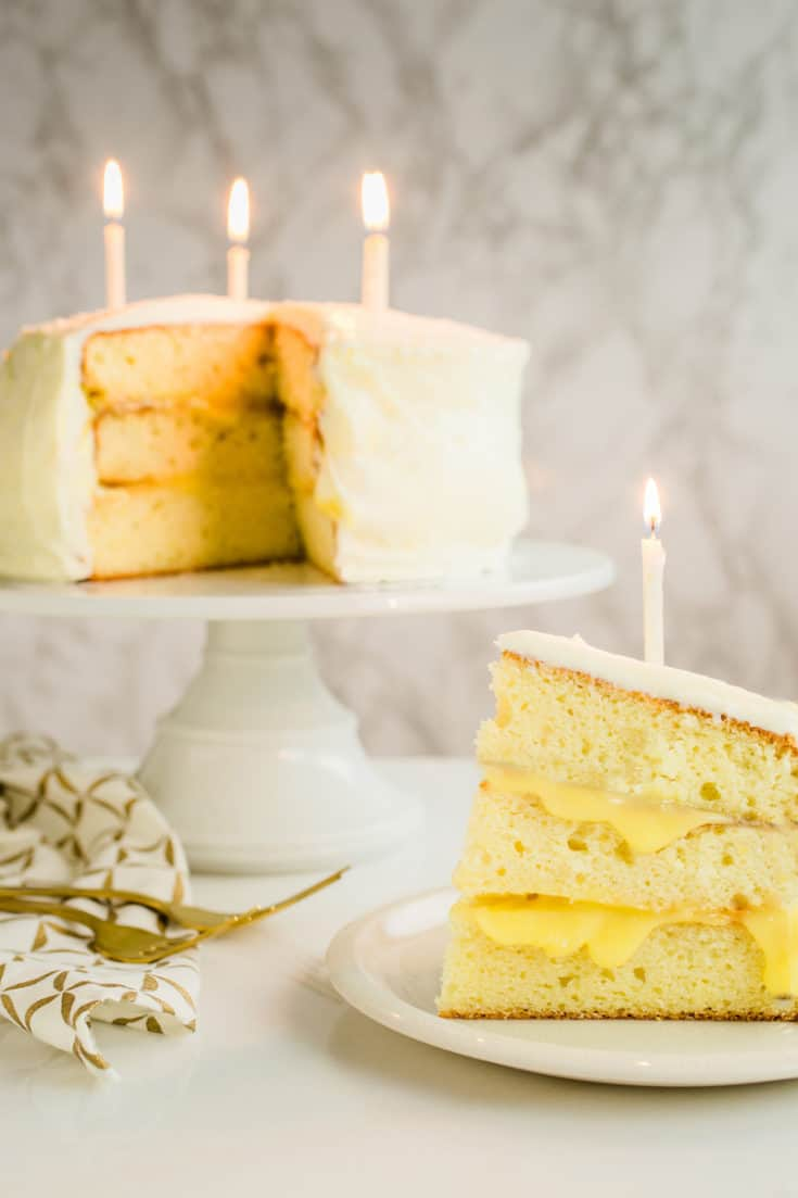 This lemon Champagne cake is a special occasion stunner! Delicate cake layers with tart lemon curd and cream cheese frosting take it over the top. #lemoncake #birthdaycake #layercake