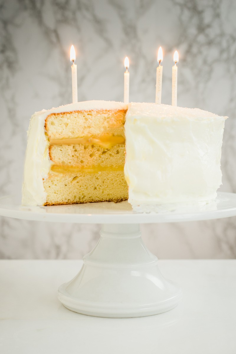 This lemon Champagne cake is a special occasion stunner! Delicate cake layers with tart lemon curd and cream cheese frosting take it over the top.