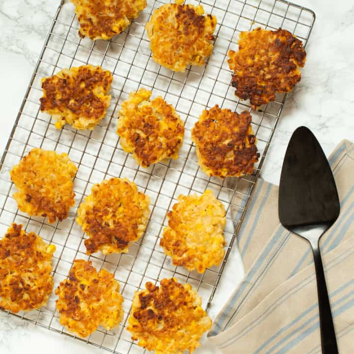 Corn fritters with sneaky cauliflower rice make a substantial vegetarian meal. Serve with your favorite dipping sauce! #cornfritters #vegetablefritters #vegetarian