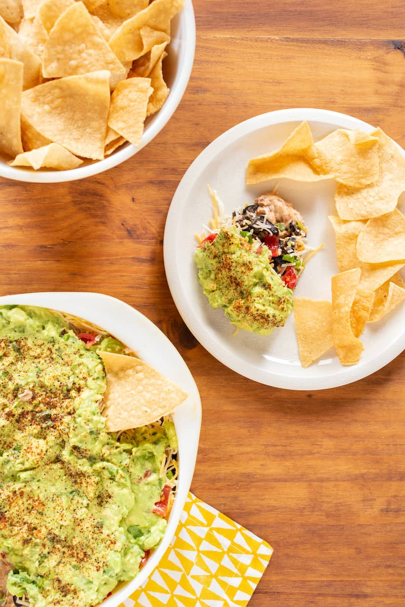 Seven layer dip is a favorite game day and party appetizer - assemble it this way for easier dipping!