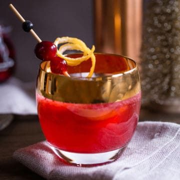 spiced cranberry and bourbon cocktail, via goodfoodstories.com