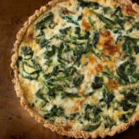 Spinach, Gruyere, and Caramelized Onion Tart with Cornmeal-Millet Crust