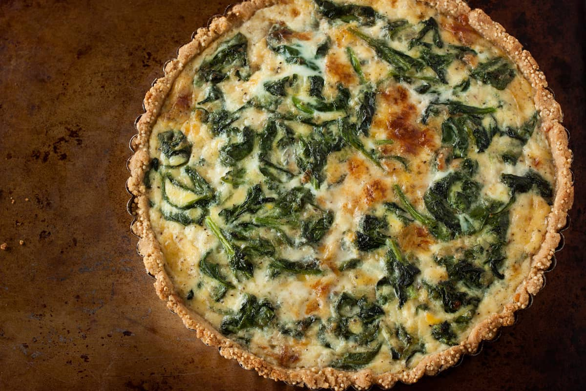 For brunch or lunch, try a caramelized onion tart with spinach, Gruyere, and a cornmeal-millet crust from the cookbook Whole-Grain Mornings.