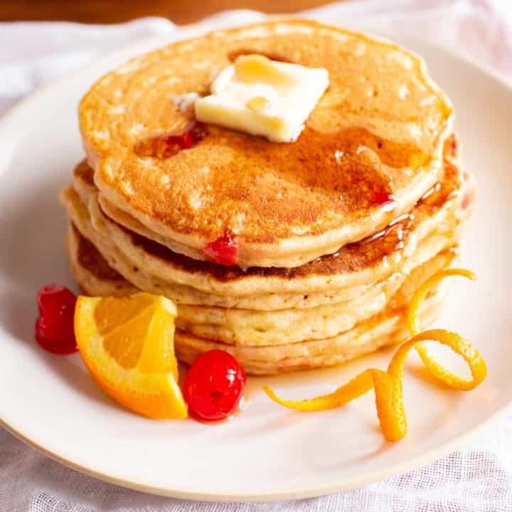 old fashioned pancakes with orange and maraschino cherries