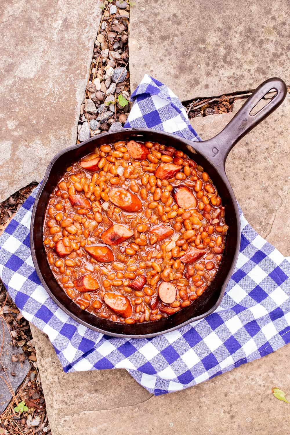 franks and beans in a cast iron skillet