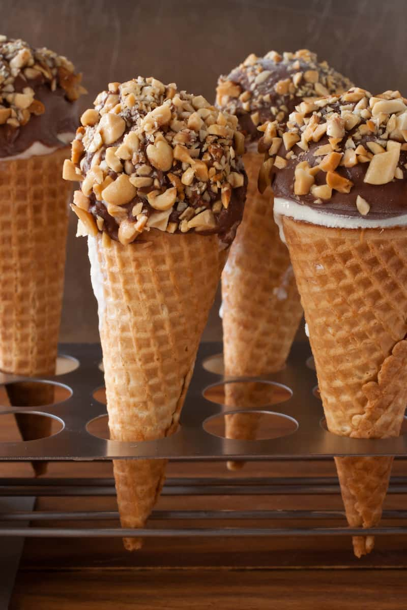 Homemade peanut butter caramel Drumstick cones topped with magic shell take the classic ice cream treat and turn it into something luxurious. #icecream #classicsnacksmadefromscratch