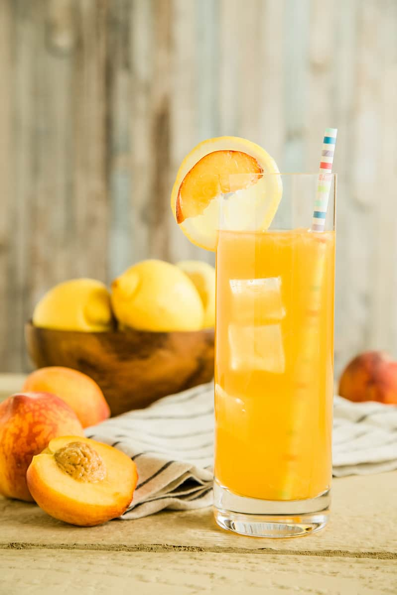 Bourbon peach lemonade made with grilled lemons and brown sugar simple syrup is an irresistible party drink for outdoor gatherings.