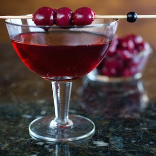 the Harvest Manhattan cocktail with applejack, nocino liqueur, and cherries - via goodfoodstories.com