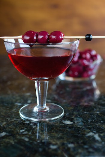 the Harvest Manhattan cocktail with applejack, nocino liqueur, and cherries - via www.www.goodfoodstories.com