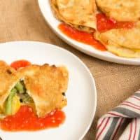 Peneques (Battered Stuffed Tortillas) with Ranchera Sauce