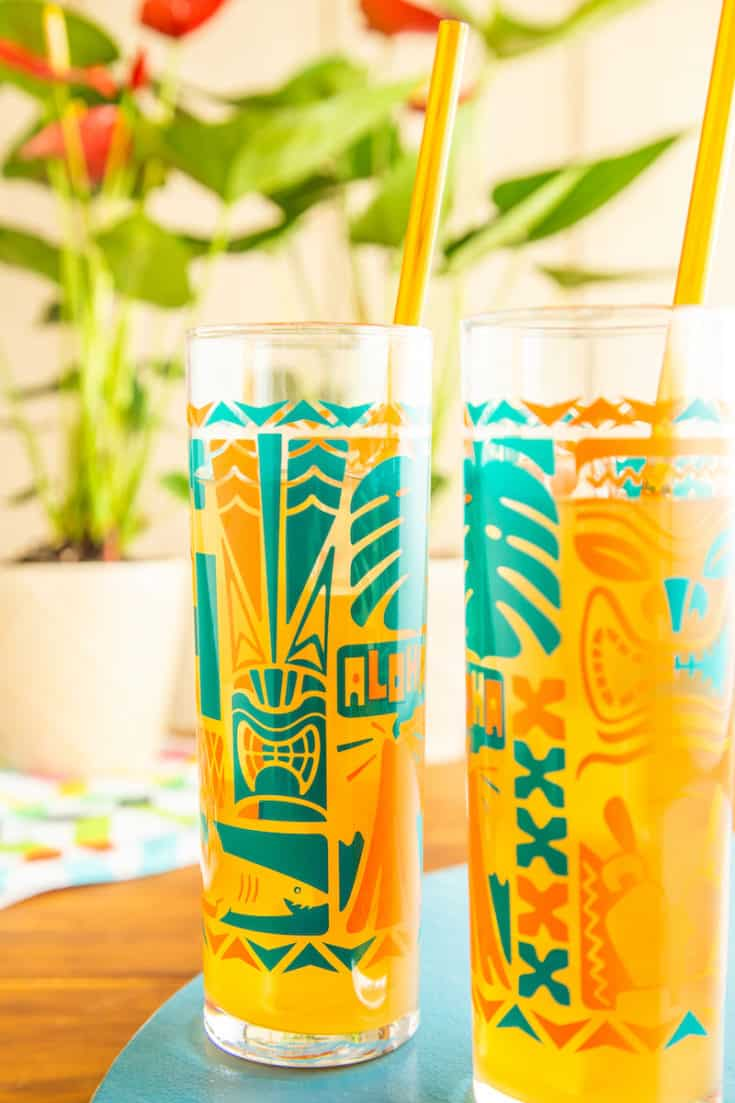 A tiki whiskey sour gives you a tropical vibe even as temperatures start to drop with the first hint of fall. Grab a cardigan and keep the party going! #tikidrinks #whiskeysour