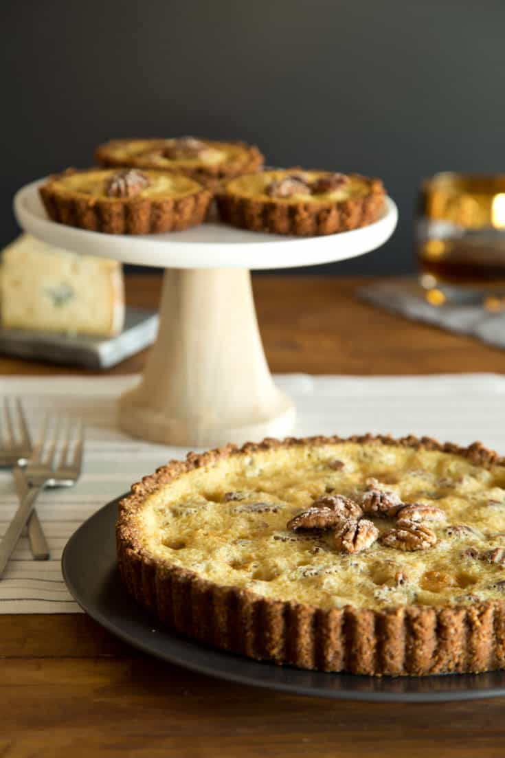 A pecan maple blue cheese bourbon tart is the flavor of fall: sweet, spicy, rich, and a little surprising. #pecantart #mapletart #holidaydessert