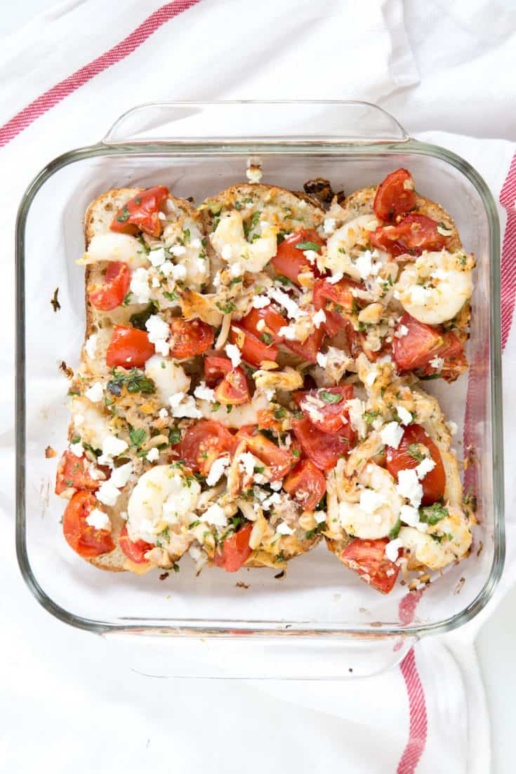 Roasted shrimp, tomato, and feta bruschetta get switched up from a handheld appetizer into a hearty weeknight family meal. #bruschetta #onepanmeal #30minutemeal