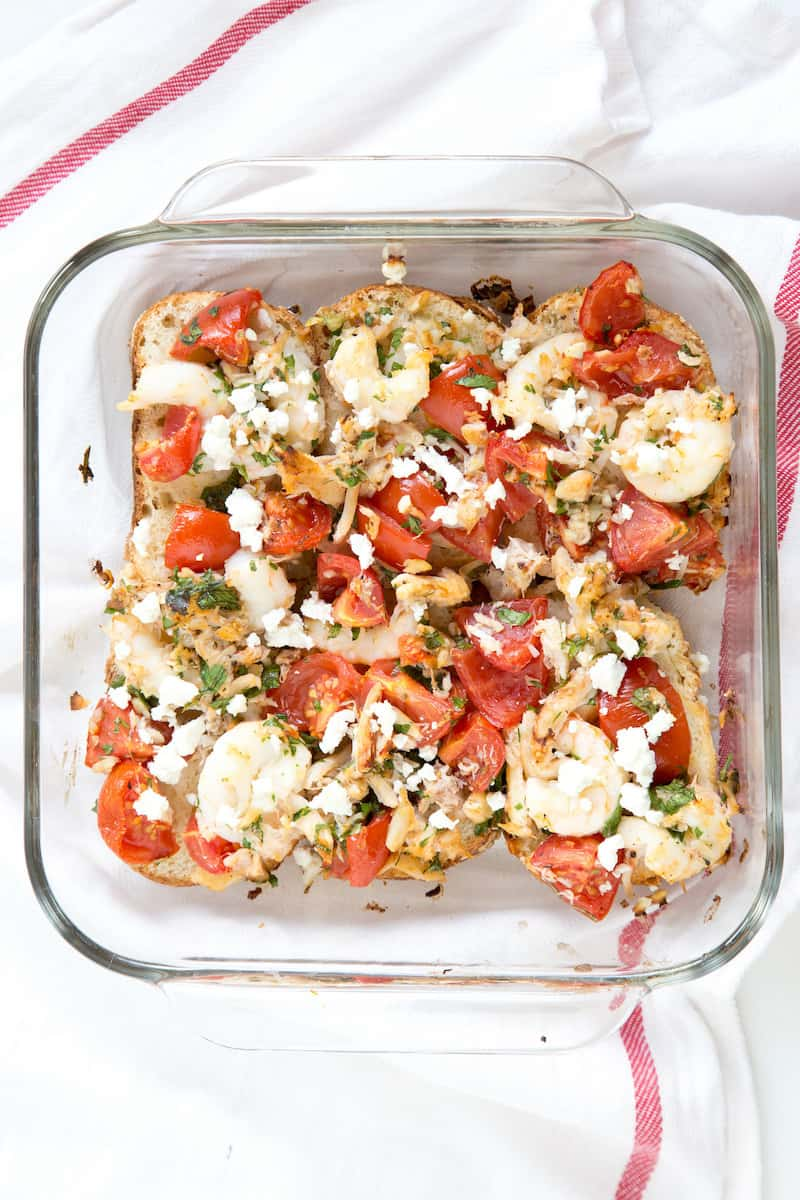 Roasted shrimp, tomato, and feta bruschetta go from a handheld appetizer into a hearty weeknight family meal.