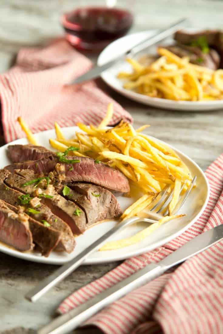 Steak frites for 2 can be made in 30 minutes on the stovetop - make it for date night tonight! #steakfrites #datenight #dinnerfortwo