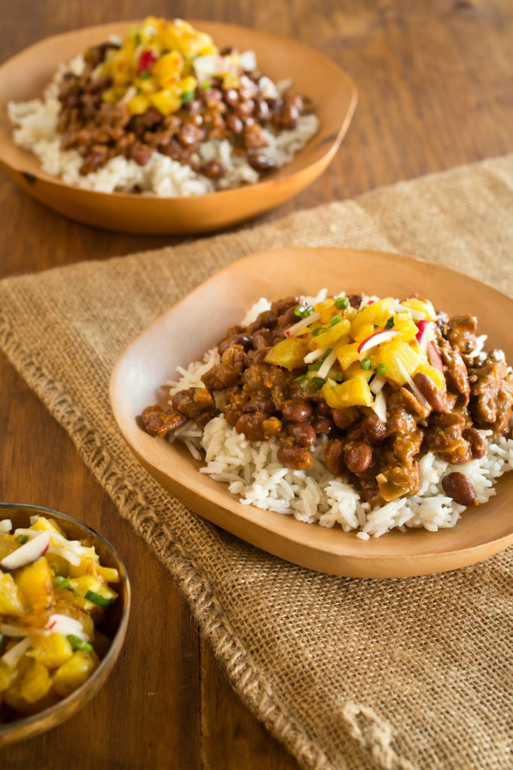 New Orleans red beans and rice is a longstanding tradition, but this quick-simmered version offers a bright pineapple salsa on the side for lightness. #riceandbeans #redbeansandrice #mardigras #neworleans