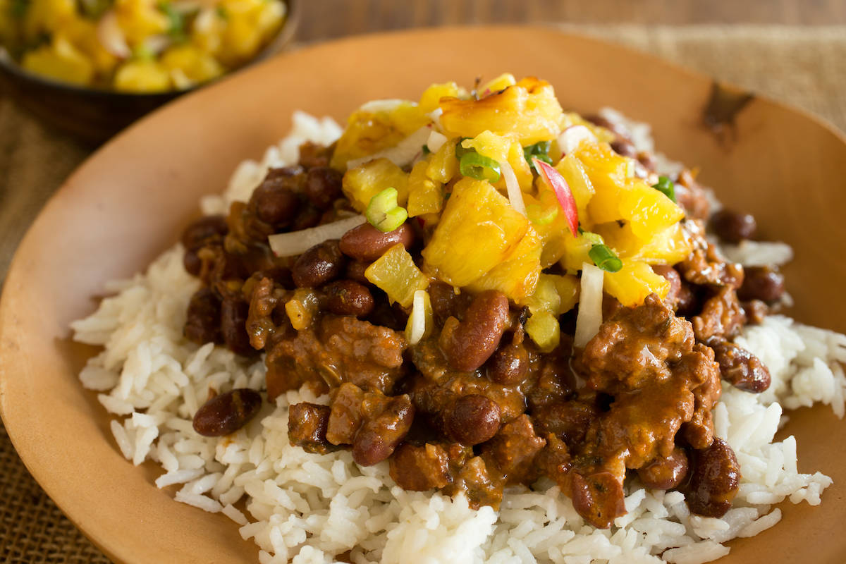 New Orleans red beans and rice is a longstanding tradition, but this quick-simmered version offers a bright pineapple salsa on the side for lightness. #beansandrice #mardigras