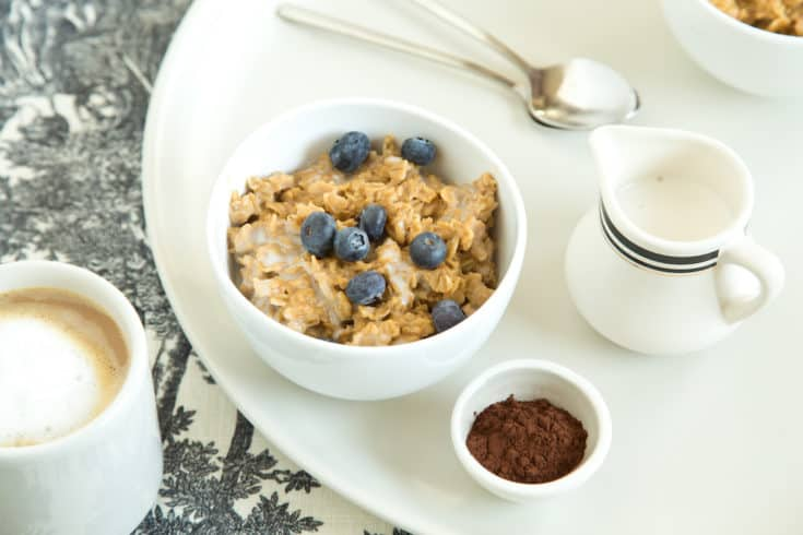Coffee oatmeal combines the best of all breakfast worlds, adding rich flavor to a morning meal and blending well with nuts, cocoa, fruit, or other mix-ins. #coffeeoatmeal #makeaheadbreakfast #overnightoats