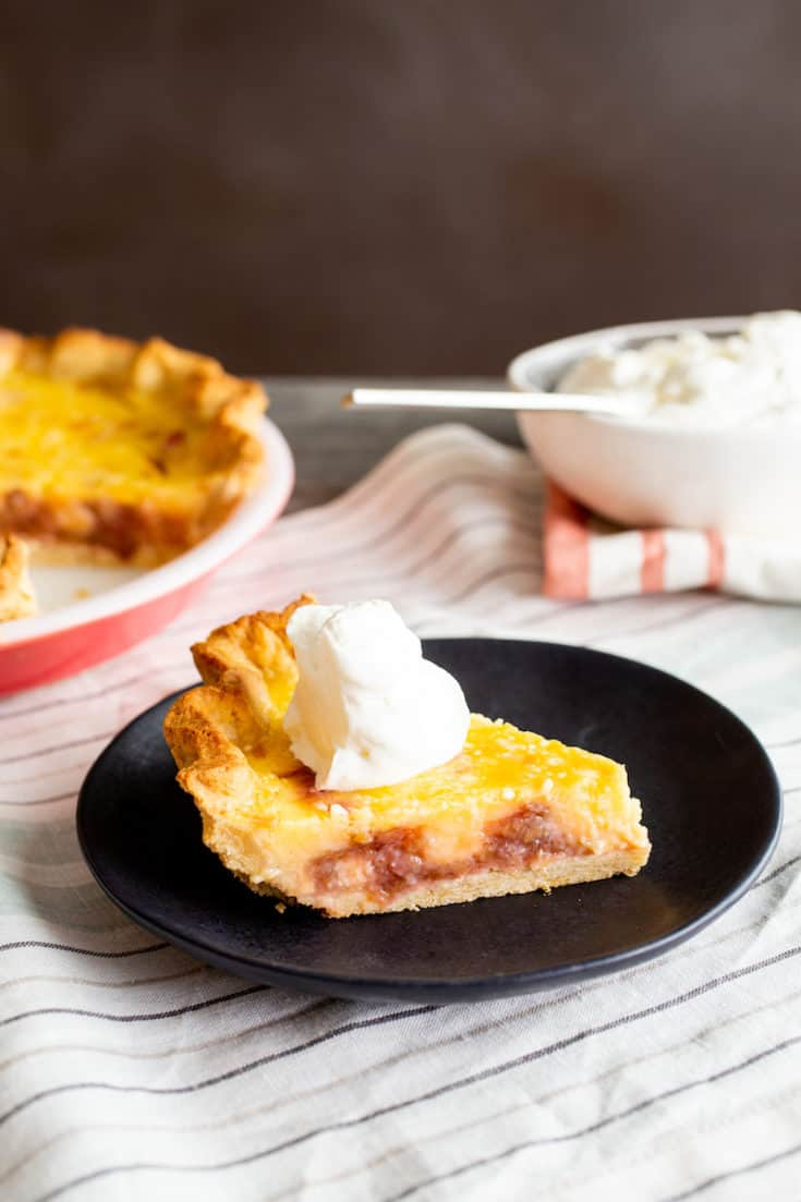 A rhubarb lemon pie made with a no-roll cookie dough crust is a damn fine way to celebrate spring. Don't forget the whipped cream. #rhubarb #lemon #pie