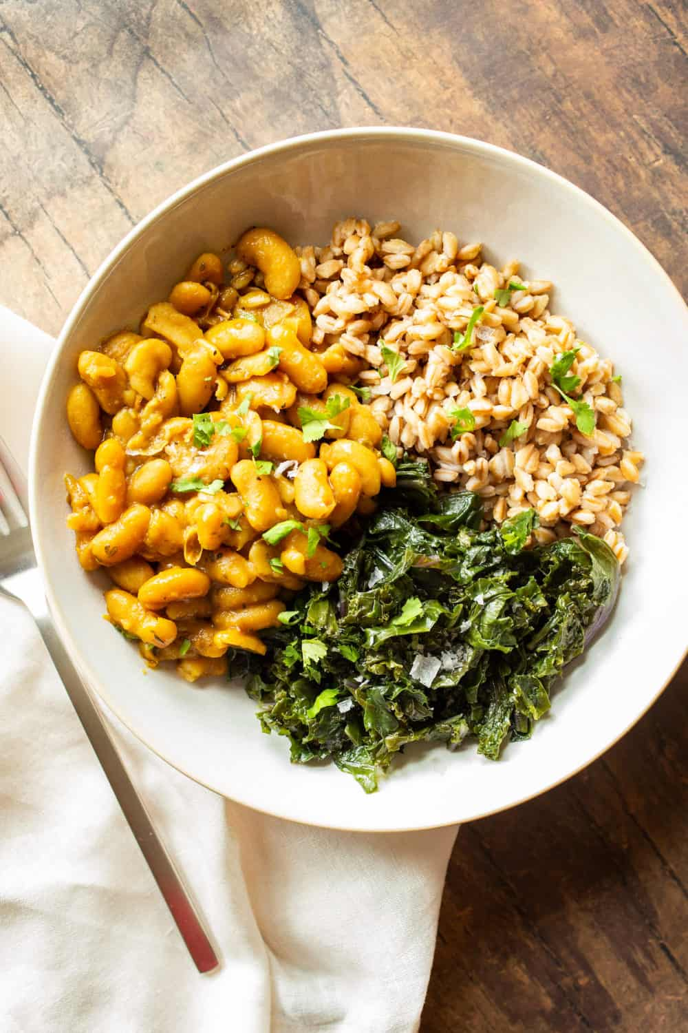 stewed cannellini beans with farro and kale