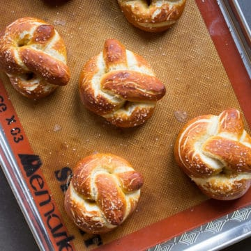 Pillowy soft pretzels baked in the oven are a surefire way to comfort and relax.