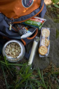the best road trip snacks and hiking snacks: KIND bars, peanut butter crackers, and string cheese